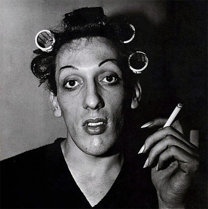 Diane Arbus, A young man with curlers at home on West 20th Street, NY. 1966