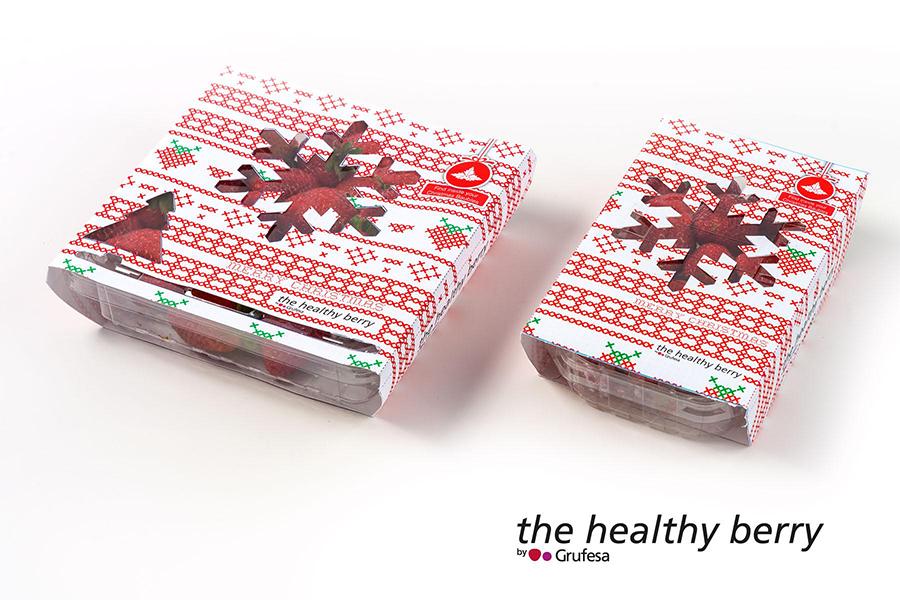 Envases de fresas con motivos navideños para captar al ávido consumidor en navidad